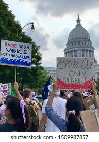 Madison, WI / USA - September 20, 2019: Protestors march to Wisconsin's state capitol building during the Global Climate Strike.