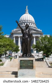 Madison, Wisconsin - 8 August 2019: the statue Forward stands in front of the south steps to the Wisconsin capitol