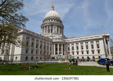 MADISON, WISCONSIN - May 10, 2014:  A group of people rally in front of the southeastern entrance to the capital building in Madison, WI on May 10, 2014.
