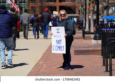 Madison, Wisconsin / USA - April 19th, 2020: Conservatives and Libertarians hold a rally and march on Madison Capitol to protest Governor Tony Evers Stay at Home order during the COVID-19 pandemic
