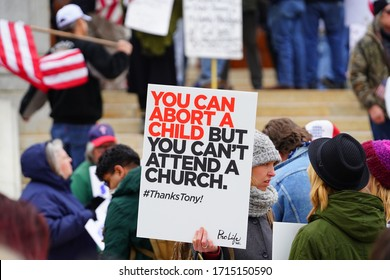 Madison, Wisconsin / USA - April 24th, 2020: Pro-life demonstrators and advocates participated at Reopen Wisconsin Rally along with those that protesting the safer at home order given by Tony Evers