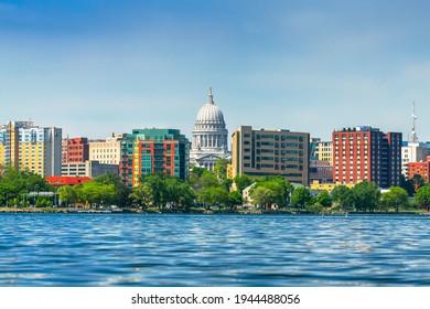 Madison, Wisconsin, USA downtown skyline on Lake Monona in the daytime.
