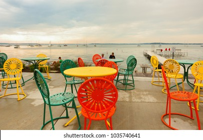 Madison, Wisconsin, USA - July 11, 2017: Colorful chairs at Memorial Union Terrace on the campus of the University of Wisconsin–Madison. The terrace a popular outdoor space overlooking Lake Mendota.