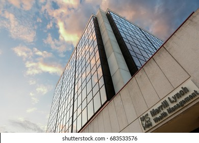 Madison Wisconsin, USA - July 11, 2017: Merrill Lynch Wealth Management Building in Madison, Wisconsin. Photo showing colorful cloud reflection on the glass wall of the building.