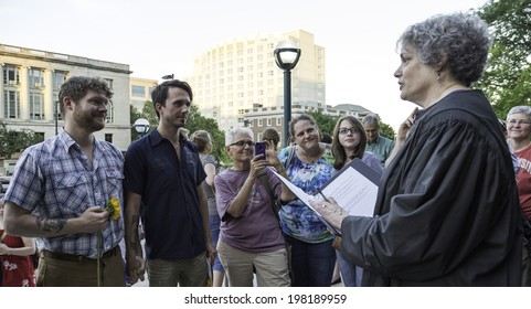 MADISON, WISCONSIN USA - JUNE 6: A gay couple getting married on the steps of the City County Building after a judge struck down Wisconsin's gay marriage ban on Friday June 6, 2014 in Madison, WI