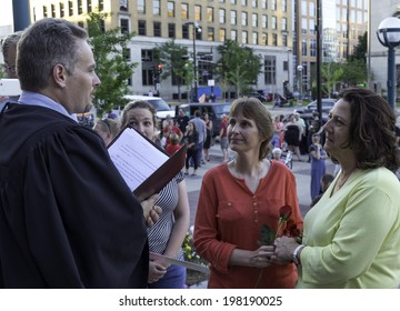 MADISON, WISCONSIN USA - JUNE 6: A lesbian couple getting married on the steps of the City County Building after a judge struck down Wisconsin's gay marriage ban on Friday June 6, 2014 in Madison, WI