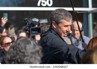 Madison, Wisconsin / USA - March 17 2019: Former Texas congressman and Democratic presidential candidate Beto O'Rourke greets supporters outside Cargo Coffee Shop on St. Patrick's Day in Madison, Wis
