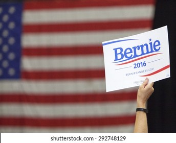 MADISON, WI/USA - July 1, 2015: A woman holds up a Bernie Sanders for President sign during a rally of over 10,000 people for Bernie Sanders in Madison, Wisconsin.