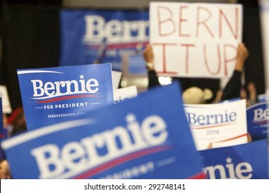 MADISON, WI/USA - July 1, 2015: A group of supporters hold up a Bernie Sanders for President sign during a rally of over 10,000 people for Bernie Sanders in Madison, Wisconsin.