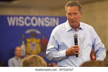 MADISON, WI/USA - March 28, 2016: Republican presidential candidate John Kasich speaks to a group of supporters during a town hall before the Wisconsin presidential primary in Madison, Wisconsin.
