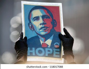 MADISON,WI-NOV. 5:A supporter holds the iconic poster of Barack Obama by Sheppard Fairey aloft at an Obama rally held the day before the 2012 election in Madison, Wisconsin on November 5, 2012.
