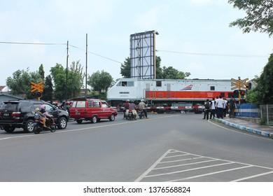 Madiun, East Java, Indonesia - May 10, 2013: Kereta Api. Argo Wilis Train Stopping in Madiun Station