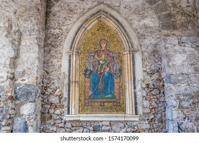 Madonna with a Child mosaic on a wall of Clock Tower located on Square of 9th April in Taromina city, Sicily Island, Italy