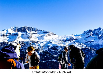 MADONNA DI CAMPIGLIO, ITALY, January 05 2015: People are making preparation for skiing, with beautiful view to mountain where are some of the most beautiful ski slopes at Madonna di Campiglio, Italy.