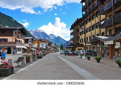 MADONNA DI CAMPIGLIO, ITALY - JULY 11: View of the street in Madonna di Campiglia town, Italy on July 11, 2014. Madonna di Campiglia is a ski resort in Dolomites Alps, Italy.