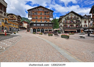 MADONNA DI CAMPIGLIO, ITALY - JULY 11: View of the main square of Madonna di Campiglia town, Italy on July 11, 2014. Madonna di Campiglia is a ski resort in Dolomites Alps, Italy.