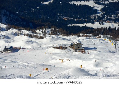 MADONNA DI CAMPIGLIO, ITALY-21 November 2014:Skiers on the Cable car to the Groste-pass, Madonna di Campiglio, skiers on slope in ski resort Italian Alps in sunny day in Madonna di Campiglio,italy