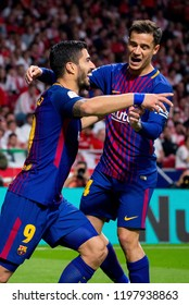 MADRID - APR 21: Luis Suarez (l) and Coutinho (r) play at the Copa del Rey final match between Sevilla FC and FC Barcelona at Wanda Metropolitano Stadium on April 21, 2018 in Madrid, Spain.