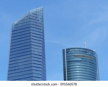 Madrid / Architecture in Four Towers Area in Madrid / picture showing the both tops of the Cristal and PWC Tower in Madrid