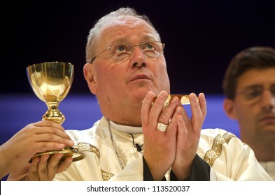 MADRID - AUGUST 19: New York Archbishop Timothy Dolan elevates the Host at the conclusion of the Eucharistic Prayer during the closing Mass at Palaciao des Desportes in Madrid on August 19, 2011.