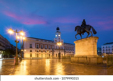 Madrid cityscape at night. Landscape of Puerta del Sol square Km 0. Historical building in Puerta del Sol square area at Madrid, Spain.