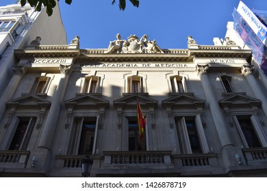 MADRID, COMMUNITY OF MADRID, SPAIN - JUNE, 16TH, 2019: Perspective of the neoclassical facade of the Royal National Academy of Medicine (Real Academia Nacional de Medicina) in Madrid