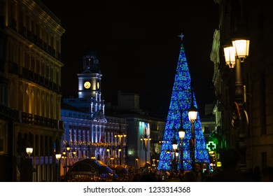 MADRID - DECEMBER 28, 2017: Crowds of people gather at the Puerta del Sol square in Madrid, Spain, with the traditional illuminated Christmas tree rising in its center.