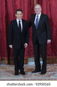 MADRID - JANUARY 16: Spain's King Juan Carlos receives France's Prime Minister Nicolas Sarkozy before receiving the Order of the Golden Fleece at the Royal Palace on January 16, 2012 in Madrid