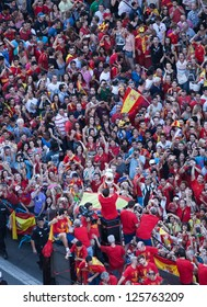 MADRID - JULY 2: The Spanish national soccer team makes a bus tour through the city center on July 2, 2012 in Madrid. The team celebrates winning the European Championship.