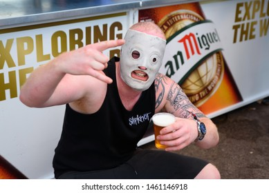 MADRID - JUN 30: A man with Slipknot's mask drinks beer in a concert at Download (heavy metal music festival) on June 30, 2019 in Madrid, Spain.