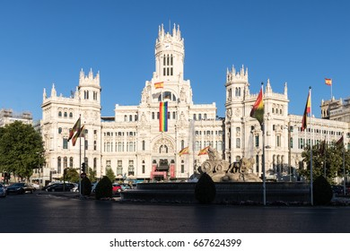 MADRID JUNE 26, 2017 Cibeles Palace: City Hall of Madrid (formerly Palace of Communication) displays a great Gay flag commemorating the World Pride 2017. In Madrid, Spain on June 26, 2017.