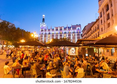 MADRID - JUNE 29, 2013: Sidewalk bars at night in Plaza Santa Ana, Huertas district