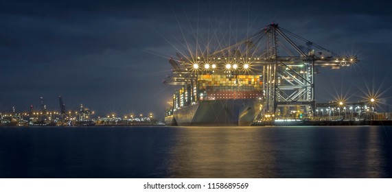 The Madrid Maersk. The worlds second largest container ship of the Maersk Shipping line, unloading at night in Felixtowe Docks, the UK's largest container port. On 20th August 2017.