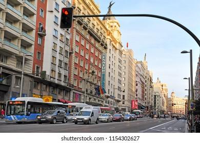 MADRID - MAR 01 2010: Traffic on the Gran Via, Madrid's High Street at dusk in Madrid, Spain.