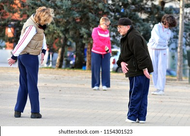 MADRID - MARCH 01 2010: Spanish  senior adults exercising in a park in Madrid, Spain.According to OECD data Spain has the second-highest life expectancy in the world after Japan, Male 80 female 85.