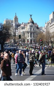 MADRID - MARCH 11: People at Calle de Alcala street overlapped during demonstration on March 11, 2012 in Madrid, Spain. Russians make up 3% of the total number of tourists visiting Spain.