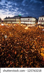 MADRID - MARCH 29: Thousands of people gather at Puerta del Sol square at the end of a day of strike on March 29, 2012 in Madrid. The nationwide strike is a reaction to announced labor reforms.