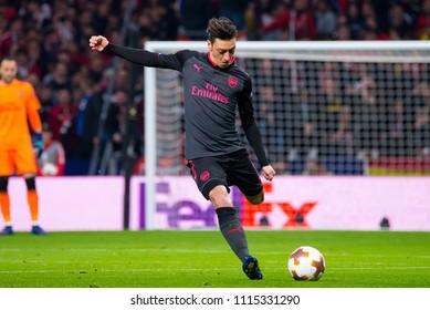 MADRID - MAY 3: Mesut Ozil plays at the Europa League Semi Final match between Atletico de Madrid and Arsenal at Wanda Metropolitano Stadium on May 3, 2018 in Madrid, Spain.