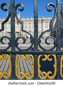 Madrid Palace viewed through the black and gold gate railings