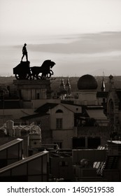 Madrid rooftop view of the city skyline and warrior statue in Spain.