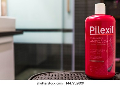 Madrid, Sapin - July 09, 2019: Pilexil brand shampoo bottle with diffused bathroom background. Pilexil is a brand specialized in shampoos anti-hair loss.