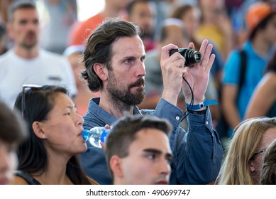 MADRID - SEP 12: A man takes a pictures with his digital camera in a concert at Dcode Festival on September 12, 2015 in Madrid, Spain.