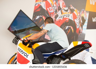 MADRID - SEP 8: A man plays a video game bike simulator at Dcode Music Festival on September 8, 2018 in Madrid, Spain.