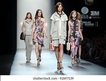 MADRID – SEPTEMBER 16: Models walking on the Adolfo Dominguez catwalk during the Cibeles Madrid Fashion Week runway on September 16, 2011 in Madrid, Spain..