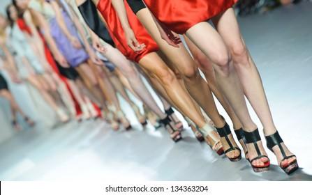 MADRID - SEPTEMBER 18: Details of models walking on the Amaya Arzuaga catwalk during the Cibeles Madrid Fashion Week runway on September 18, 2011 in Madrid.