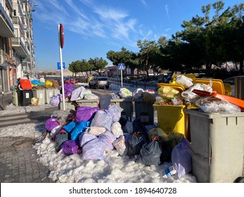 Madrid, Spain- 01 12 2021: Accumulation of garbage due to the lack of public services due to the historic snow storm in Madrid that leaves the city collapsed with the amount of accumulated snow.