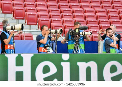 Madrid, Spain - 01 MAY 2019: Photojournalist with a camera shoots a match during the UEFA Champions League 2019 final match at Wanda Metropolitano, Spain