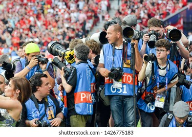 Madrid, Spain - 01 MAY 2019: Photojournalists take pictures with cameras during the UEFA Champions League 2019 final match between FC Liverpool  vs Tottenham Hotspur at Wanda Metropolitano, Spain