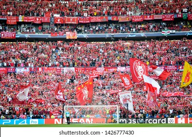 Madrid, Spain - 01 MAY 2019: Liverpool fans in the stands support the team during the UEFA Champions League 2019 final match between FC Liverpool  vs Tottenham Hotspur at Wanda Metropolitano, Spain