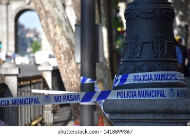 Madrid / Spain - 02 06 2019: Police tape wrapped around a street light to limit the perimeter of a crime scene or a suspected bomb site.